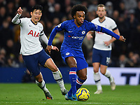 Football - 2019 / 2020 Premier League - Tottenham Hotspur vs. Chelsea<br /> <br /> Chelsea's Willian holds off the challenge from Tottenham Hotspur's Son Heung-Min, at The Tottenham Hotspur Stadium.<br /> <br /> COLORSPORT/ASHLEY WESTERN