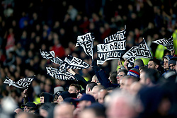 Derby County fans in the stands wave flags in the crowd to show their support