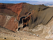 "Red volcanic vent on North Island, New Zealand. Tongariro National Park served as a location for fictional Mordor and Mount Doom in the ""Lord of the rings"" Motion Pictures. In 1990 and 1993, UNESCO honored Tongariro National Park as a World Heritage Area and Cultural Landscape."