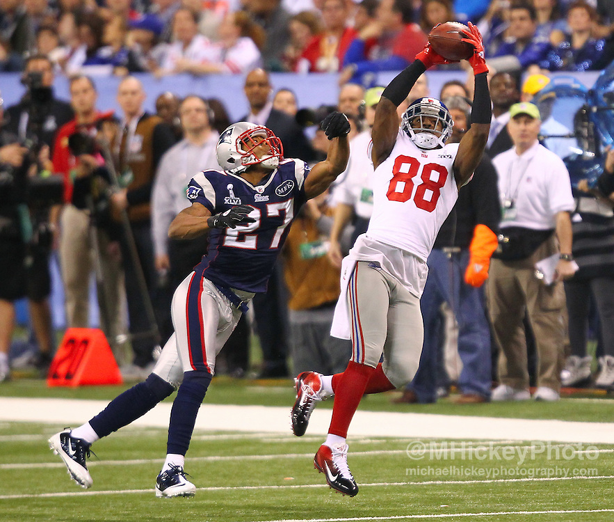 Feb 5, 2012; Indianapolis, IN, USA; New York Giants wide receiver Hakeem Nicks (88) makes a catch in front of New England Patriots cornerback Antwaun Molden (27) during the first half of Super Bowl XLVI at Lucas Oil Stadium.
