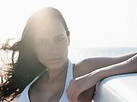 Young woman in bikini against sea