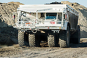 A Kress CH-200 coal truck is used to transport the coal from the mine directly to the power plant. The truck can hold 200 tons of coal. As with other machines at the mine, a sense of scale is missing here as the truck is about 17 feet tall, 21 feet wide and 65 feet long.