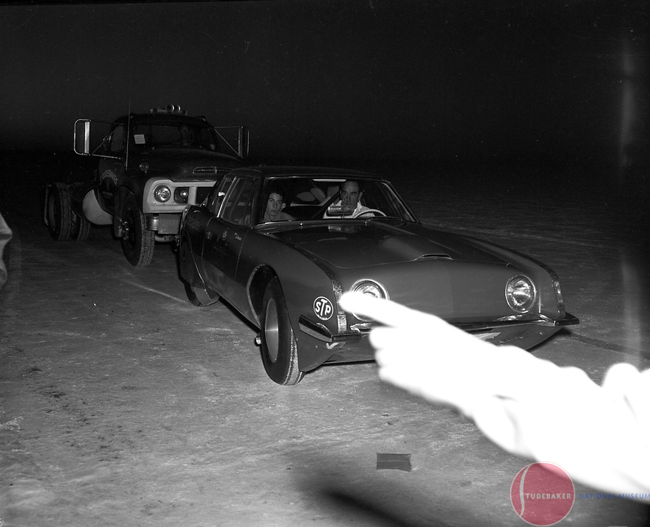 "The Studebaker Avanti ""Due Cento"" is pushed by an E40 truck at the Bonneville Salt Flats in October, 1963."