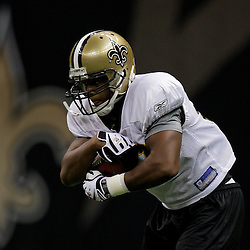 24 August 2009: New Orleans Saints running back Pierre Thomas (23) runs with the ball during New Orleans Saints training camp practice at the Louisiana Superdome in New Orleans, Louisiana.