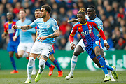 Manchester City defender Kyle Walker (2) and Crystal Palace forward Wilfried Zaha (11) during the Premier League match between Crystal Palace and Manchester City at Selhurst Park, London, England on 14 April 2019.