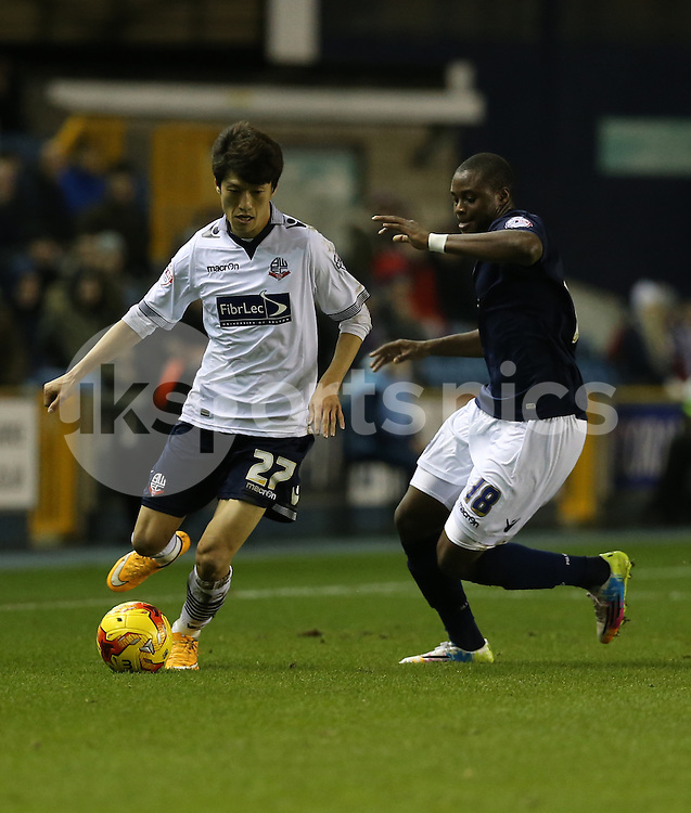 Bolton's Lee Chung-Yung and Millwall's Magaye Gueye during the Sky Bet Championship match between Millwall and Bolton Wanderers at The Den, London, England on 19 December 2014. Photo by Dave Peters.