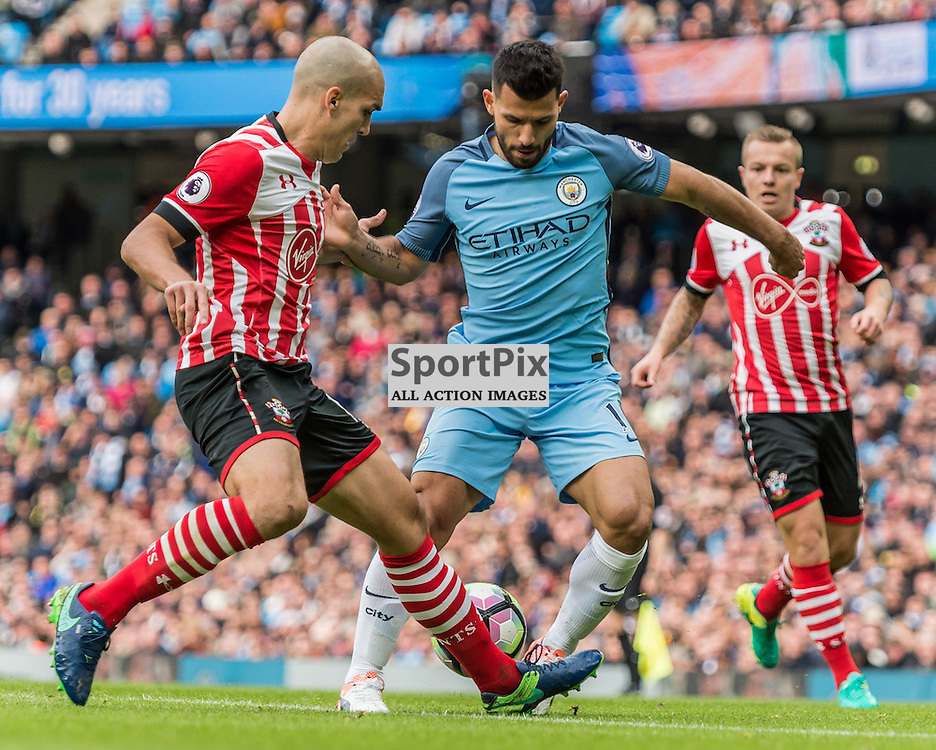 Southampton midfielder Oriol Romeu (14) and Manchester City forward Sergio Aguero (10) challenge for a loose ball in the Premier League match between Manchester City and Southampton<br /> <br /> (c) John Baguley | SportPix.org.uk