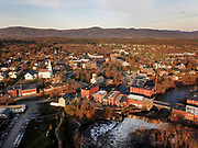 Early spring drone view of Otter Creek Falls and Middlebury, Vermont.