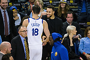 Golden State Warriors guard Stephen Curry (30) celebrates with Golden State Warriors forward Omri Casspi (18) during a time out against the Utah Jazz at Oracle Arena in Oakland, Calif., on December 27, 2017. (Stan Olszewski/Special to S.F. Examiner)