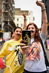 "© Licensed to London News Pictures. 05/09/2018. LONDON, UK.  A fan of Freddie Mercury and a fundraising volunteer in Carnaby Street don moustaches during ""Freddie for a Day"", a fundraising event in aid of the Mercury Phoenix Trust on Freddie Mercury's birthday.  Queen tribute band ""Bulsara and the Queenies"" sang iconic songs entertaining crowds.  Photo credit: Stephen Chung/LNP"