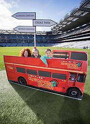 Repro Free: 03/03/2014 Alisha Burke (6) from Artane, Ella Crolly (7) from Malahide and Kyle Burkem, (6) from Donaghmede find themselves in the middle of Croke Park as they help launch of the new City Sightseeing bus route at Croke Park stadium which now encompasses the Botanic Gardens, Glasnevin Cemetery and Croke Park.<br /> The new route will be open to the public from March 10th 2014 and extends the existing tour route. This &lsquo;true blue&rsquo; route will take visitors on a journey that gives an insight into the struggles and victories that shaped this country encapsulating social, cultural and sporting history, amazing views and landscapes from three of Dublin&rsquo;s top 10 attractions (Tripadvisor). In this decade of commemorations, these sites are at the forefront in remembering and commemorating great events and people in Irish history. Picture Andres Poveda