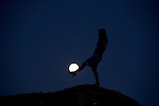 ZAOZHUANG, CHINA - SEPTEMBER 27: (CHINA OUT) <br /> <br /> <br /> A woman poses with the full moon during the Mid-Autumn Festival on September 27, 2015 in Huaian, Jiangsu Province of China. The Mid-Autumn Day falls on Sep 27 this year.<br /> ©Exclusivepix Media