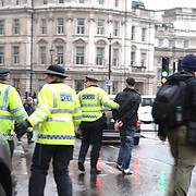 A protester is being arrested by the police following some skirmishes. Trafalgar square, London.