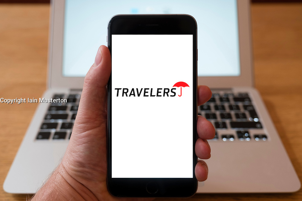 Using iPhone smartphone to display logo of Travellers insurance company