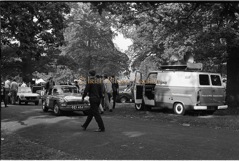 16/09/1967<br /> 09/16/1967<br /> 16 September 1967<br /> Phoenix Park Motor Racing, Kingsway Trophy Race, sponsored by Player and Wills (Ireland) Limited.  <br /> Image shows Player and Wills (Ireland) Ltd. van and closest to the camera K.J. Farrell's M.G.B. (27)