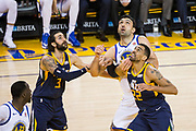 Golden State Warriors center Zaza Pachulia (27) battles for a rebound against the Utah Jazz at Oracle Arena in Oakland, Calif., on December 27, 2017. (Stan Olszewski/Special to S.F. Examiner)