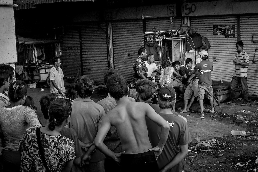 A fight breaks out between two young men in Borei Keila. The community of Borei Keila in Phnom Penh was once home to hundreds of families before land developer Phanimex bought the property rights to the area and forcefully evicted the residents who refused to accept their compensation package. Those who remained were forced to squat in the remains of the buildings, living in slum-like conditions and without access to plumbing or public electiricity.