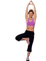 beautiful mature woman yoga tree pose on isolated white background doing stretching exercise