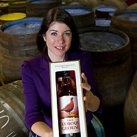 The Edrington Group Packaging Team....29.09.10<br /> Angela Spink with a bottle of Famous Grouse whisky<br /> Picture by Graeme Hart.<br /> Copyright Perthshire Picture Agency<br /> Tel: 01738 623350  Mobile: 07990 594431