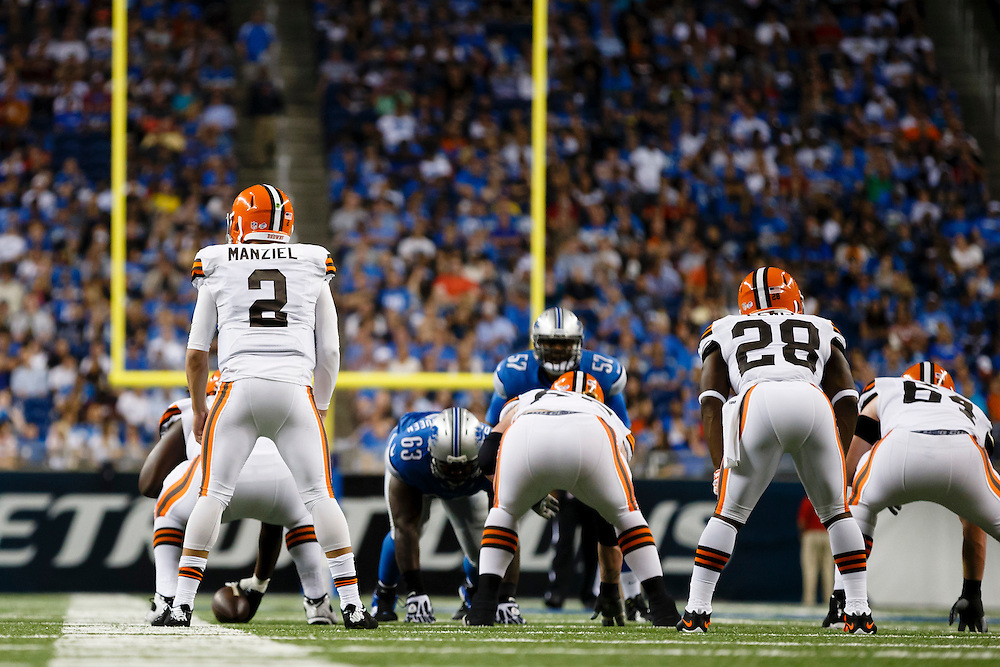 Cleveland Browns quarterback Johnny Manziel (2) gets set to run a play against the Detroit Lions during a preseason NFL football game at Ford Field in Detroit, Saturday, Aug. 9, 2014. (AP Photo/Rick Osentoski)