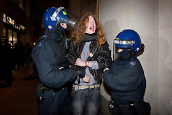 © Licensed to London News Pictures. 28/02/2012. LONDON, UK. An Occupy London protester, one of the last to be removed from the site, reacts after being detained by police. After being camped outside St Paul's Cathedral in London for four months anti-capitalist Occupy London demonstrators were tonight evicted by police and bailiffs who moved in shortly after midnight. Photo credit: Matt Cetti-Roberts/LNP