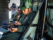 09 JANUARY 2016 - BANGKOK, THAILAND: Children sit in a Thai Army Blackhawk helicopter during Children's Day festivities at the Royal  Thai Army's Palace Guard, 2nd Division Cavalry Base in Bangkok. National Children's Day falls on the second Saturday of the year. Thai government agencies sponsor child friendly events and the military usually opens army bases to children, who come to play on tanks and artillery pieces.         PHOTO BY JACK KURTZ