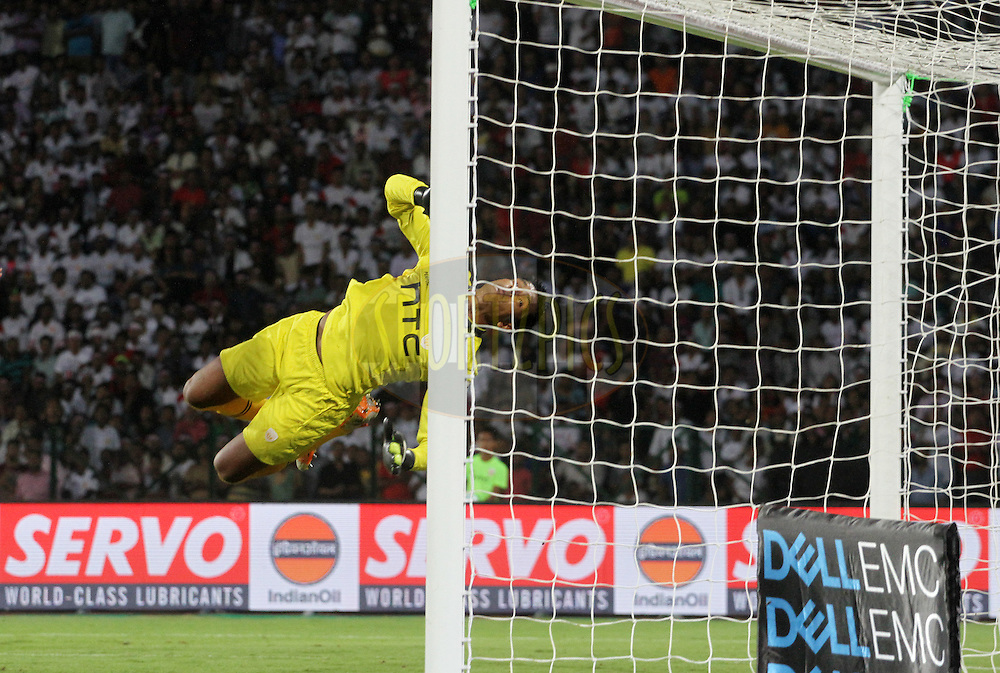 NorthEast United FC goalkeeper Subrata Paul dives to save a goal during match 18 of the Indian Super League (ISL) season 3 between NorthEast United FC and Chennaiyin FC held at the Indira Gandhi Athletic Stadium in Guwahati, India on the 20th October 2016.<br /> <br /> Photo by Vipin Pawar / ISL/ SPORTZPICS