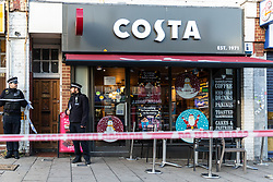 A police cordon is in place in the are surrounding a Costa Coffee outlet on Bowes Road in Arnos green following a stabbing in which a male victim has been left in critical condition. Arnos Grove, North London, November 12 2018.