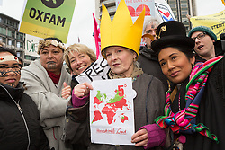 © Licensed to London News Pictures. 29/11/2015. London, UK. VIVIENNE WESTWOOD and EMMA THOMPSON join protesters to take part in the People's March for Climate, Justice and Jobs in central London. Marchers are calling for world leaders take further measures to combat climate change and environmental issues. Demonstrations are taking place around the globe today to demand United Nations action against climate change, calling on world leaders to cease political posturing and commit to a concrete international plan for people affected by climate change at the UN Paris Climate Change Summit. Photo credit : Vickie Flores/LNP