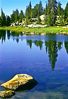 Reflections in a alpine tarn on the Beartooth Plateau.  Beartooth Mountains, Wyoming.