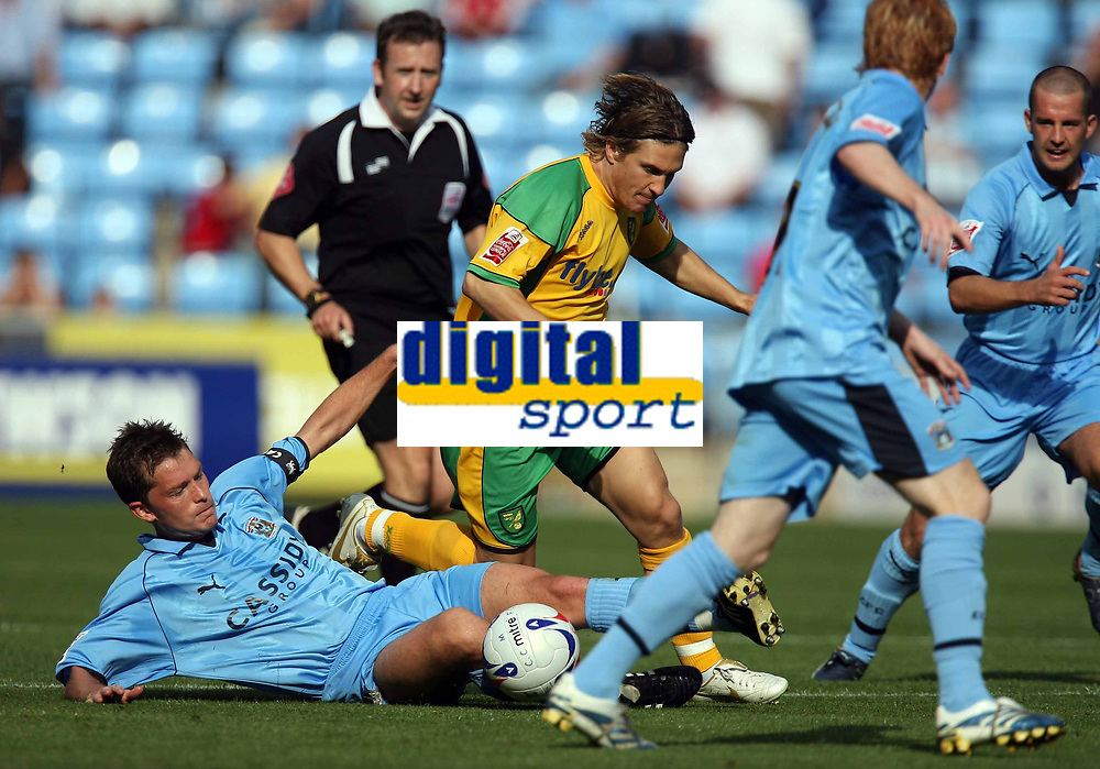 Photo: Rich Eaton.<br /> <br /> Coventry City v Norwich City. Coca Cola Championship. 09/09/2006. Stephen Hughes, captain of Coventry on floor left, tackles Norwichs Paul McVeigh