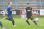 Ben Purrington of AFC Wimbledon (3) passes the ball forward under pressure from Matty Kosylo of FC Halifax Town (7) during the The FA Cup 2nd round match between FC Halifax Town and AFC Wimbledon at the MBi Shay Stadium, Halifax, United Kingdom on 1 December 2018.