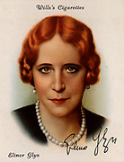 Elinor Glyn (born Sutherland - 1864-1943).  Glamorous British writer of sensational romantic novels.   Originator of the term 'It' for sex appeal. The popular verse about her: Would you like to sin/With Elinor Glyn/On a tiger skin?/Or would you prefer/To err with her/On some other fur? alludes to a scene of passionate love on a tiger skin which features in her best known novel 'Three Weeks' (1907). From a series of cards of 'Famous British Authors' (London, 1937).