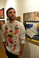 Huntington, New York, USA. February 20, 2014. BRANDON PETERSON is wearing a festive funny sweater decorated with cats in Christmas stockings, at the Jingle Boom Holiday Bash.