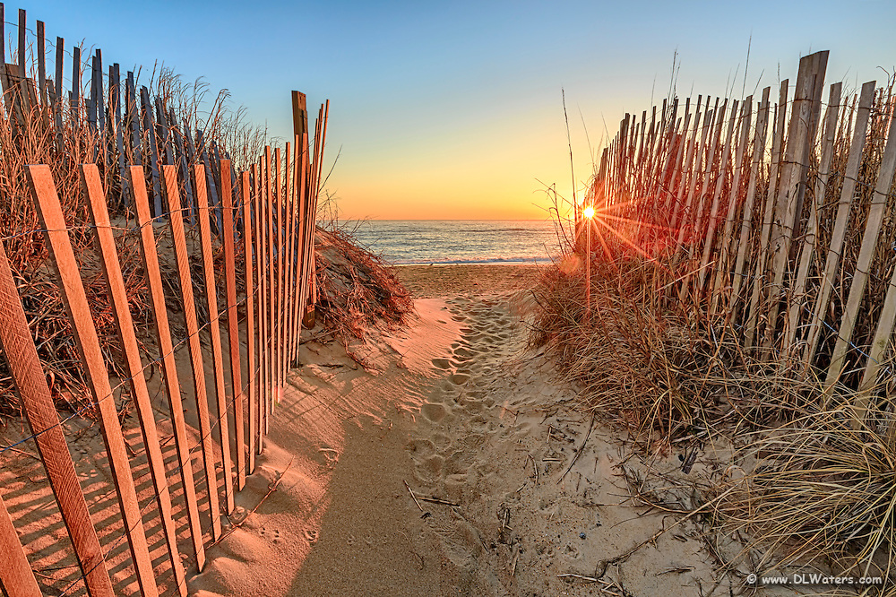 Sunrise over the Atlantic Ocean at Kitty Hawk Beach on the Outer Banks of NC.