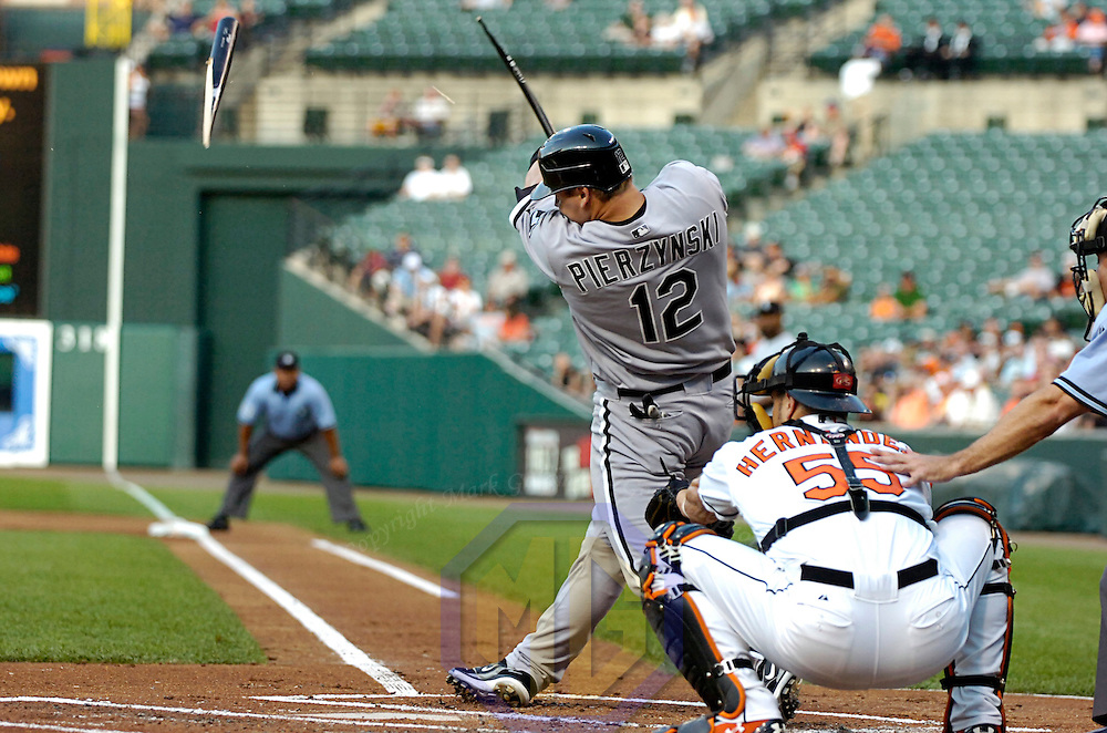 12 July 2007:  Chicago White Sox catcher A.J. Pierzynski (12) hits a broken bat single in the 1st inning against Baltimore Orioles pitcher Jeremy Guthrie.  The White Sox defeated the Orioles 9-7 at Camden Yards in Baltimore, MD.   ****For Editorial Use Only****
