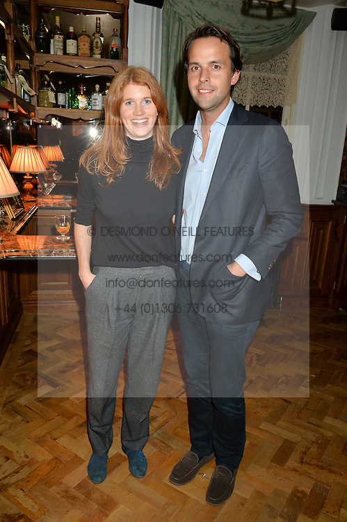 LARA HUGHES-YOUNG and CHARLIE GILKES at the opening party of Mr Fogg's Tavern, 58 St.Martin's Lane, London hosted by William Sitwell on 8th October 2015.