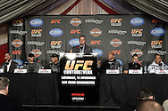 MANCHESTER, ENGLAND, NOVEMBER 12, 2009: Marshall Zelaznik (center) is flanked by fighters at the stat of the pre-fight press conference for UFC 105 at the MEN Arena in Manchester, England on November 12, 2009.