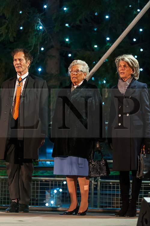 © Licensed to London News Pictures. 03/12/2015. London, UK. Her Highness Princess Astrid of Norway (centre) prepares to switch on the annual Christmas Tree lights in Trafalgar Square.  The tree, a Norwegian spruce, is donated by the City of Oslo to the people of London each year as a token of gratitude for Britain's support during the Second World War. Photo credit : Stephen Chung/LNP