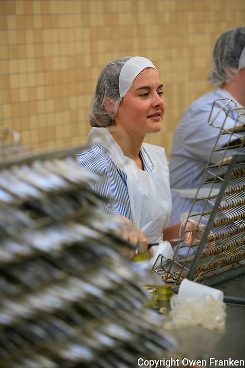 packing sardines at the factory of La Quiberonnaise, considered the best conserves of Quiberon...photo by Owen Franken for the NY Times..July 8, 2008.. Canning sardines at the Quiberonnaise factory in Quiberon, Brittany