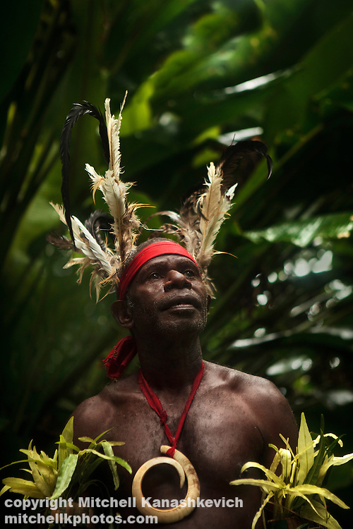 Portrait of chief Ayar with pig tusk and adornments. In Vanuatu curved pig tasks symbolize chiefly status. Near the village of Wintua, South West Bay, Malekula, Vanuatu