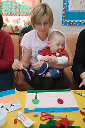 Baby with mother at adult education centre,