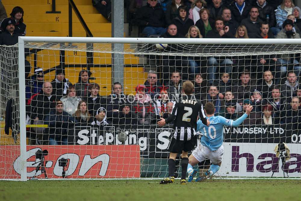NOTTINGHAM, ENGLAND - Sunday, January 30, 2011: Manchester City's Edin Dzeko scores the equalising goal against Notts County during the FA Cup 4th Round match at Meadow Lane. (Photo by David Rawcliffe/Propaganda)