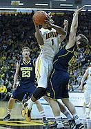 January 14, 2011: Iowa Hawkeyes forward Melsahn Basabe (1) drives around Michigan Wolverines forward Blake McLimans (22) and Michigan Wolverines guard Zack Novak (0) during the NCAA basketball game between the Michigan Wolverines and the Iowa Hawkeyes at Carver-Hawkeye Arena in Iowa City, Iowa on Saturday, January 14, 2011.