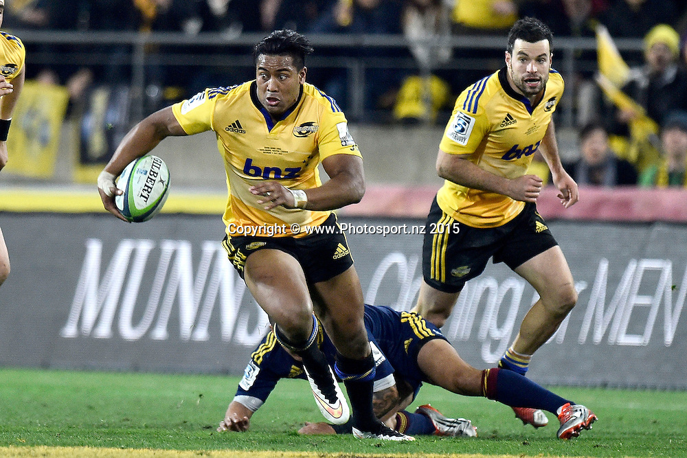 Julian Savea (L) of the Hurricanes is tackled by Lima Sopoaga of the Highlanders with team mate James Marshall (R in support during the Super Rugby final rugby match between the Hurricanes and Highlanders at the Westpac Stadium in Wellington on Saturday the 4th of July 2015. Copyright photo by Marty Melville / www.Photosport.nz