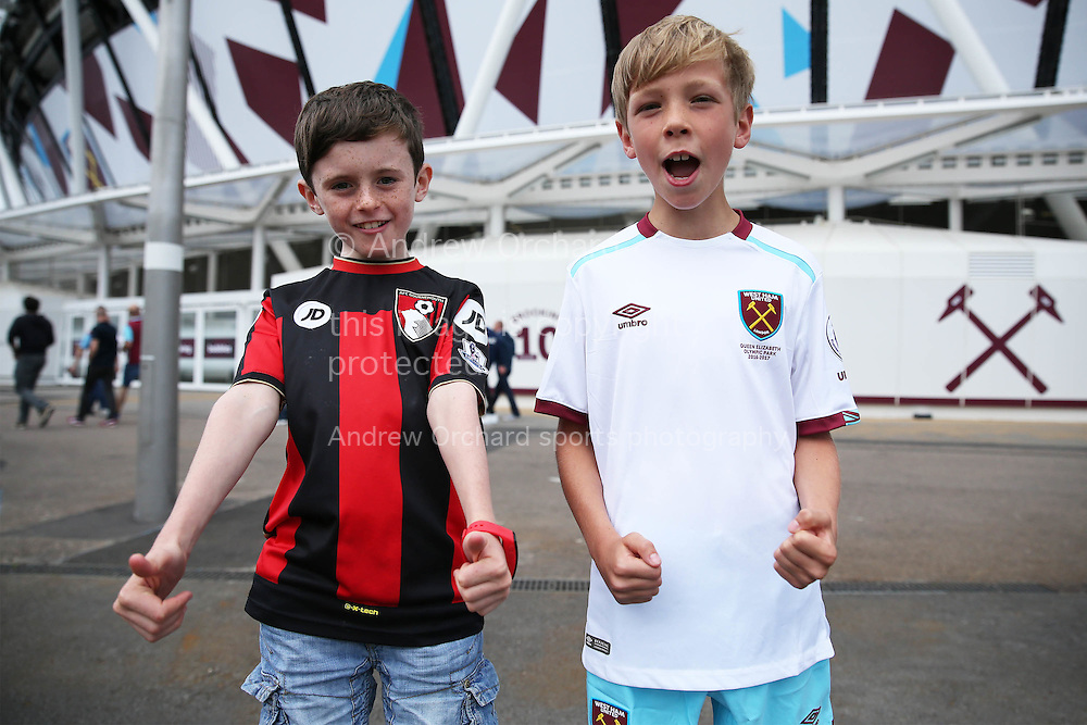 a Young Bournemouth &amp; young West Ham United fan pose for a photo outside London Stadium before k/o. Premier league match, West Ham Utd v AFC Bournemouth at the London Stadium, Queen Elizabeth Olympic Park in London on Sunday 21st August 2016.<br /> pic by John Patrick Fletcher, Andrew Orchard sports photography.