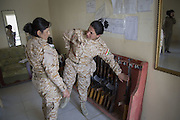Sulaymaniyah, Iraq - <br /> <br /> Female Fighters of The Peshmerga<br /> As ISIS has swept across northern Iraq, they have become known for their atrocities towards women. However, there's a group of women that aren't preparing to flee ISIS but instead are preparing to meet them with their AK-47s. The 2nd Peshmerga, are a battalion of Kurdish fighters &sbquo;&Auml;&igrave; and they just happen to be an all-female soldiers. They're front line troops, some of whom have been fighting for years, and they are eager to face ISIS. Dressed in army fatigues and armed with rifles, they are ready to lay down their lives to protect the Kurdish homeland against the threat of ISIS. They carry out training exercises and look no different from other Kurdish soldiers - except for a hint of makeup on some faces and long hair escaping from their caps. The 2nd Battalion consists of 550 mothers, sisters and daughters and was formed in 1996. Over the past month, they have moved into disputed areas abandoned by Iraqi security forces during the Isis advance. They have also recently seized control of oil production facilities at Bai Hassan and Kirkuk - the female Peshmerga will now be part of a mission to secure the city and its surrounding oil fields.<br /> <br /> Two women Peshmerga of the 2nd Battalion make sure all AK-47's have been returned after a military exercise. <br /> &copy;Excluisvepix Media