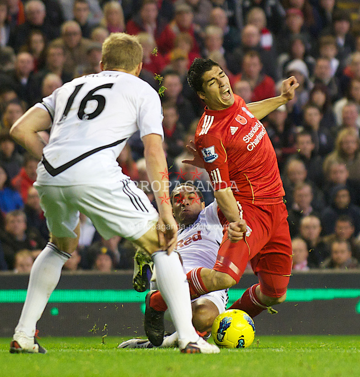 LIVERPOOL, ENGLAND - Saturday, November 5, 2011: Liverpool's Luis Alberto Suarez Diaz is fouled by Swansea City's Ashley Williams during the Premiership match at Anfield. (Pic by David Rawcliffe/Propaganda)