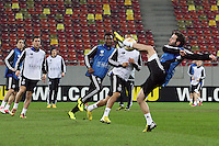 Chelsea's forward Juan Mata controls the ball as he takes part in a training session on March 6, 2013 at the National Arena Stadium one day before the UEFA Europa League football match against Steaua Bucharest.