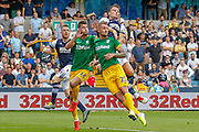 Millwall defender Alex Pearce (15), Preston North End defender Andrew Hughes (16), Preston North End defender Patrick Bauer (21) and Millwall striker Matt Smith (10) during the EFL Sky Bet Championship match between Millwall and Preston North End at The Den, London, England on 3 August 2019.